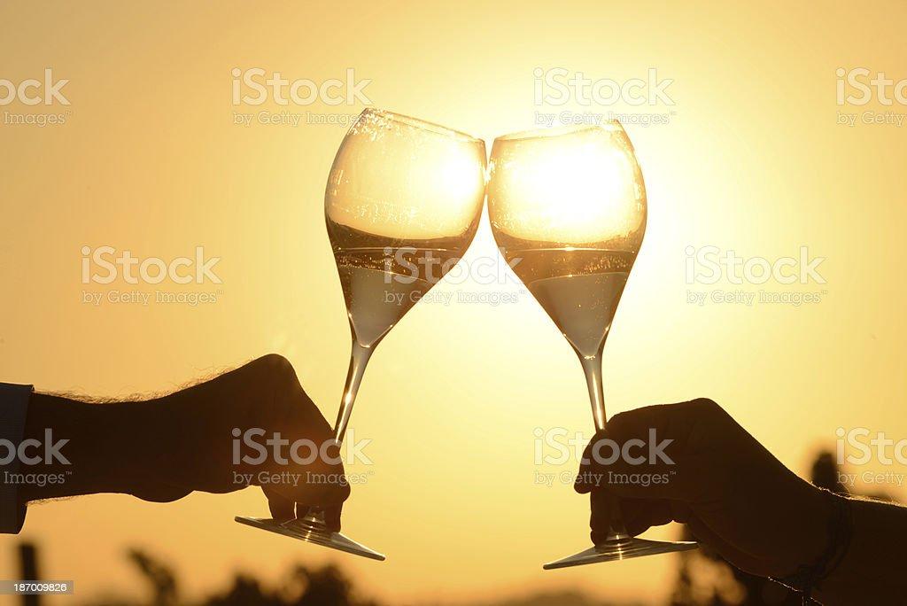 toasting at sunset stock photo