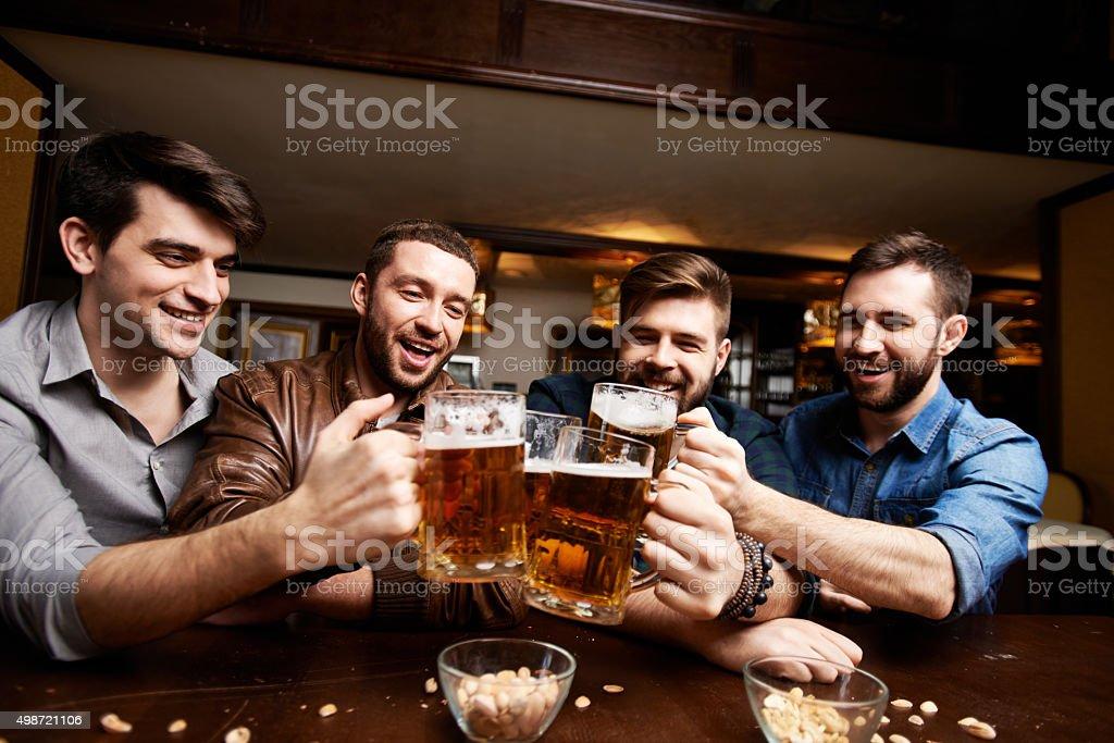 Toasting beer buddies stock photo