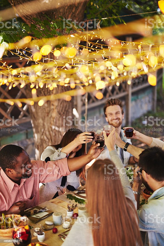 Toasting by table stock photo