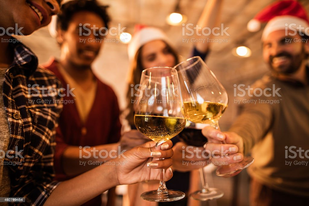 Close up of group of business people toasting with wine during a...