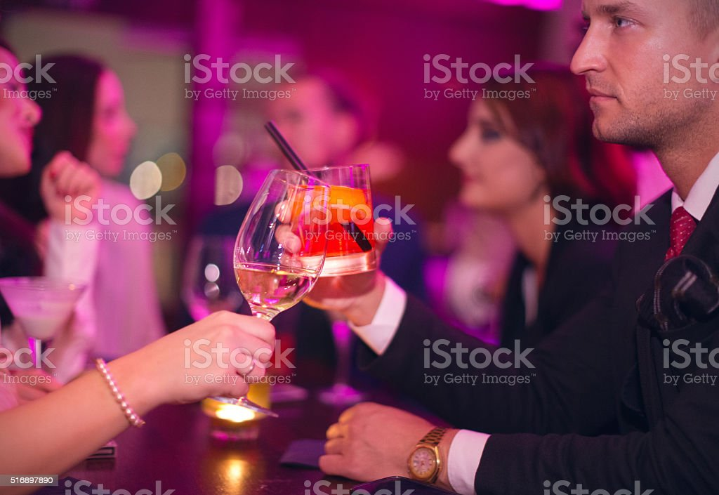 Toasting in nightclub stock photo