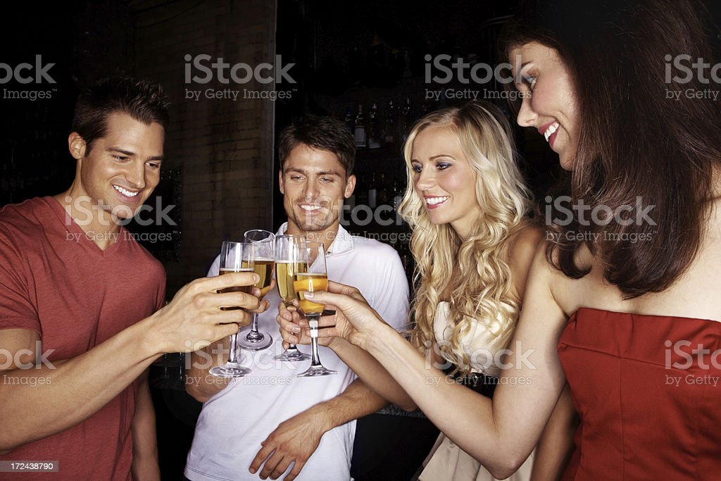 Toasting to a great evening out royalty-free stock photo
