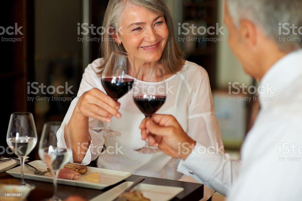 Toasting to their relationship stock photo