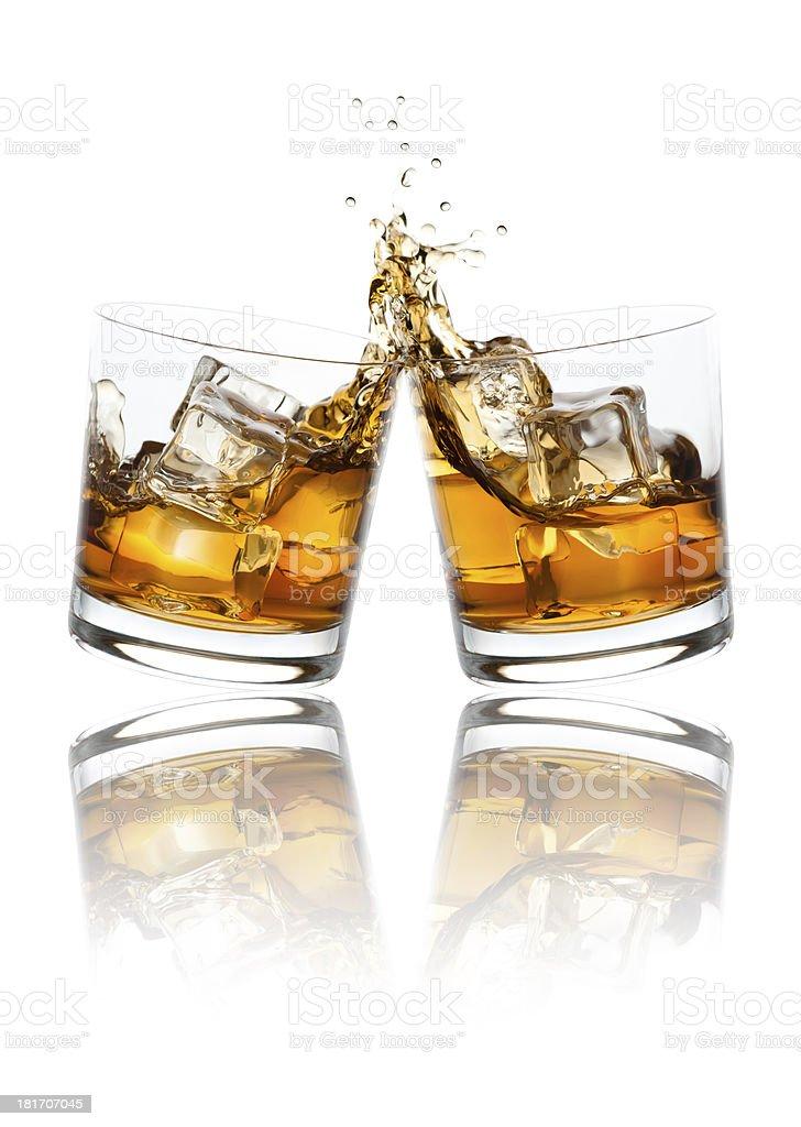 Toasting Whiskey Glasses stock photo