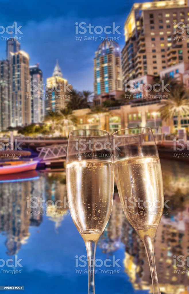 Toasting with champagne against Dubai marina in United Arab Emirates stock photo