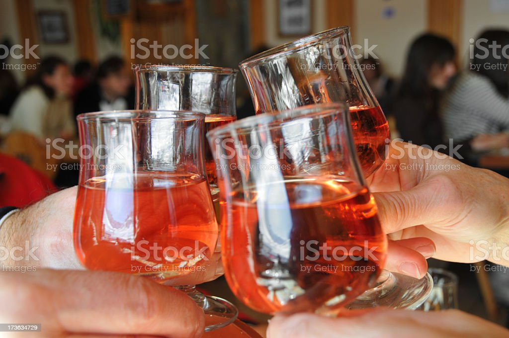 Toasting with four glasses of wine royalty-free stock photo