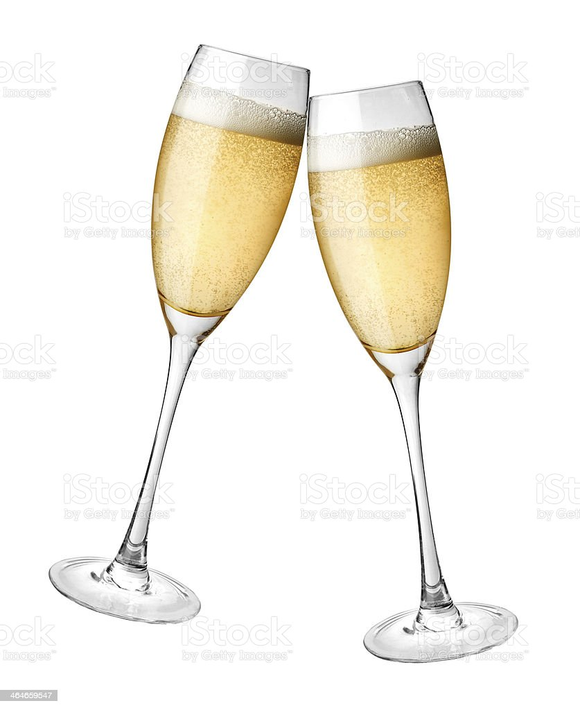 Toasting with golden champagne in long fluted glasses stock photo