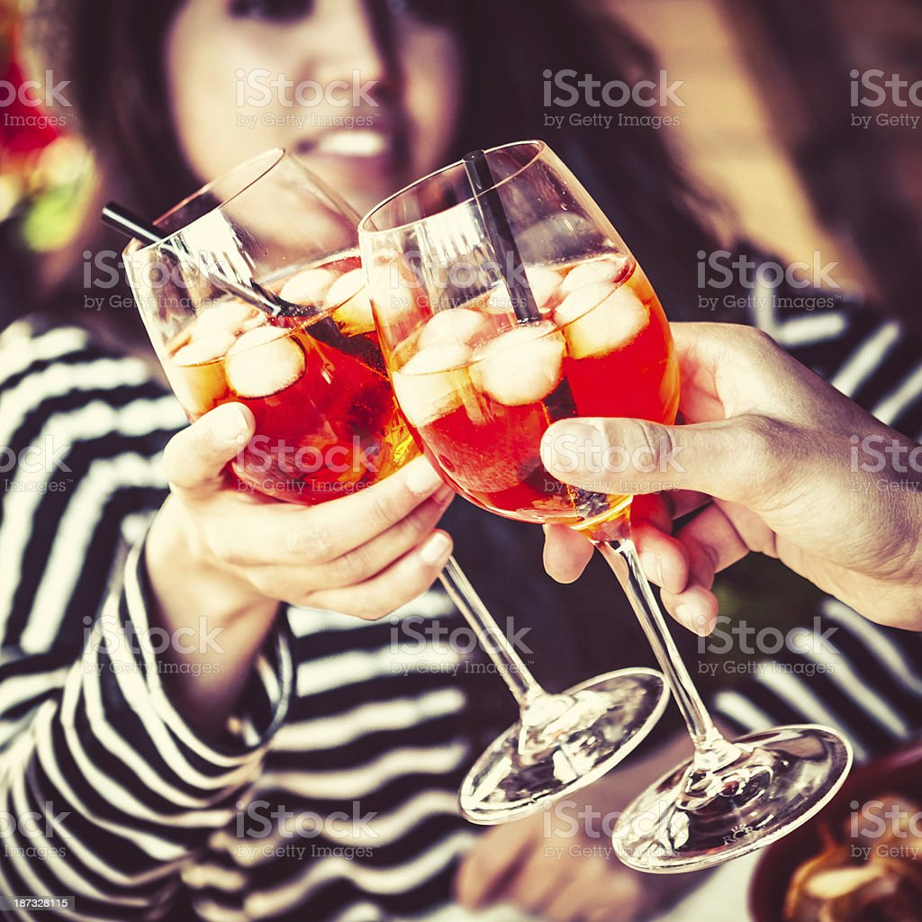 Toasting with Italian Aperitif at the Outdoors Cafe royalty-free stock photo