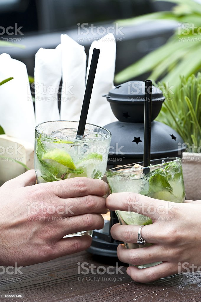 Toasting with Mojito Cocktails royalty-free stock photo