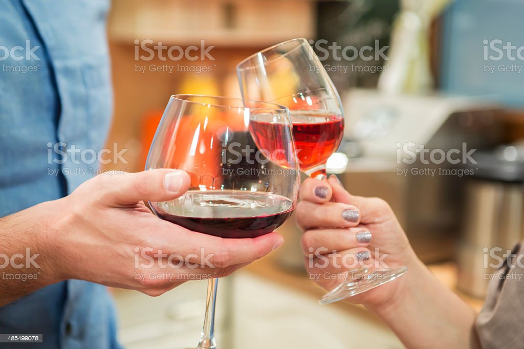 Toasting with red wine. stock photo