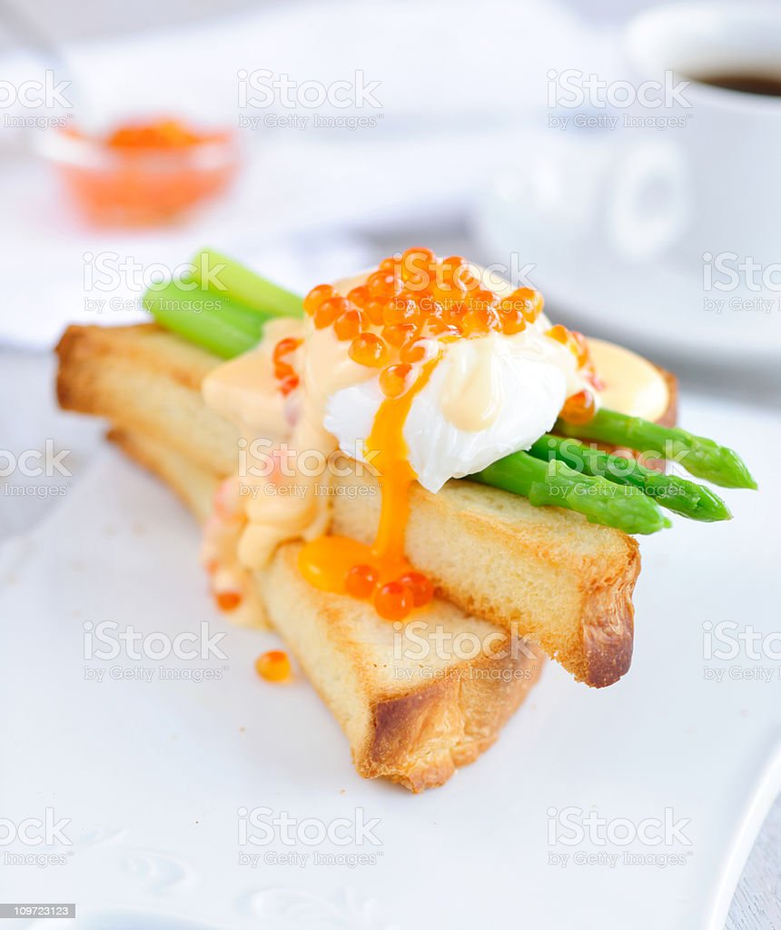 Toasts with Asparagus, Egg Benedict and Red Caviar stock photo