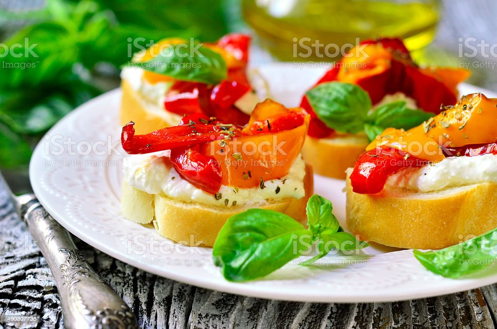 Toasts with brynza and grilled sweet pepper. stock photo
