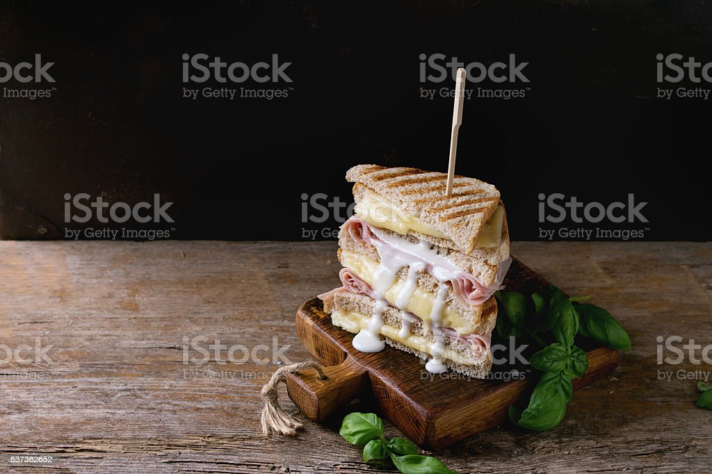 Toasts with cheese and ham stock photo