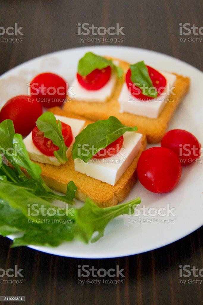 Brinda con formaggio e pomodoro foto stock royalty-free