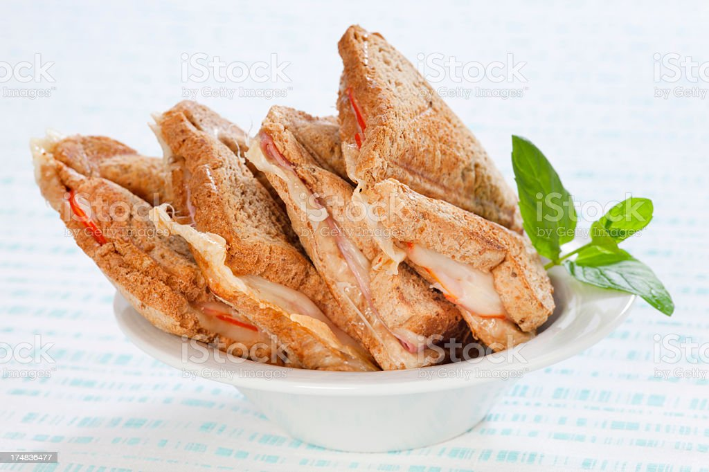 Toasts with ham and cheese on plate royalty-free stock photo