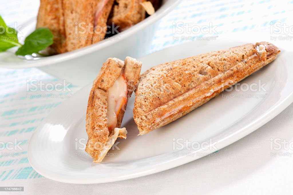 Toasts with ham and cheese on plates royalty-free stock photo