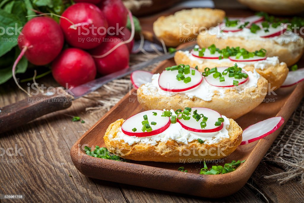 Toasts with radish, chives and cottage cheese. stock photo