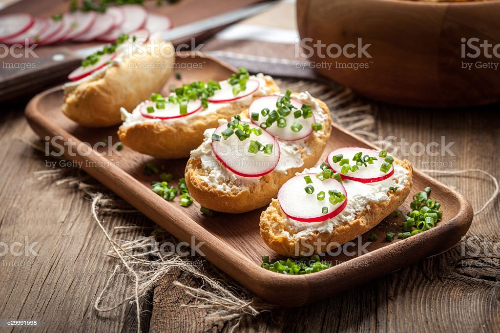 Toasts with radish, chives and cottage cheese stock photo
