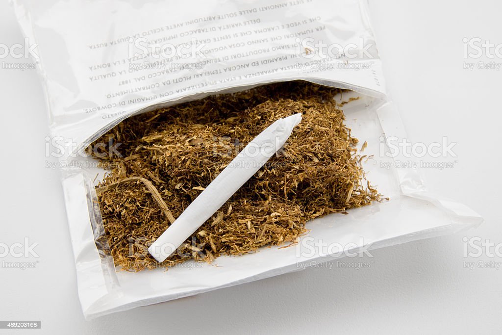 tobacco and hand made cigarette stock photo