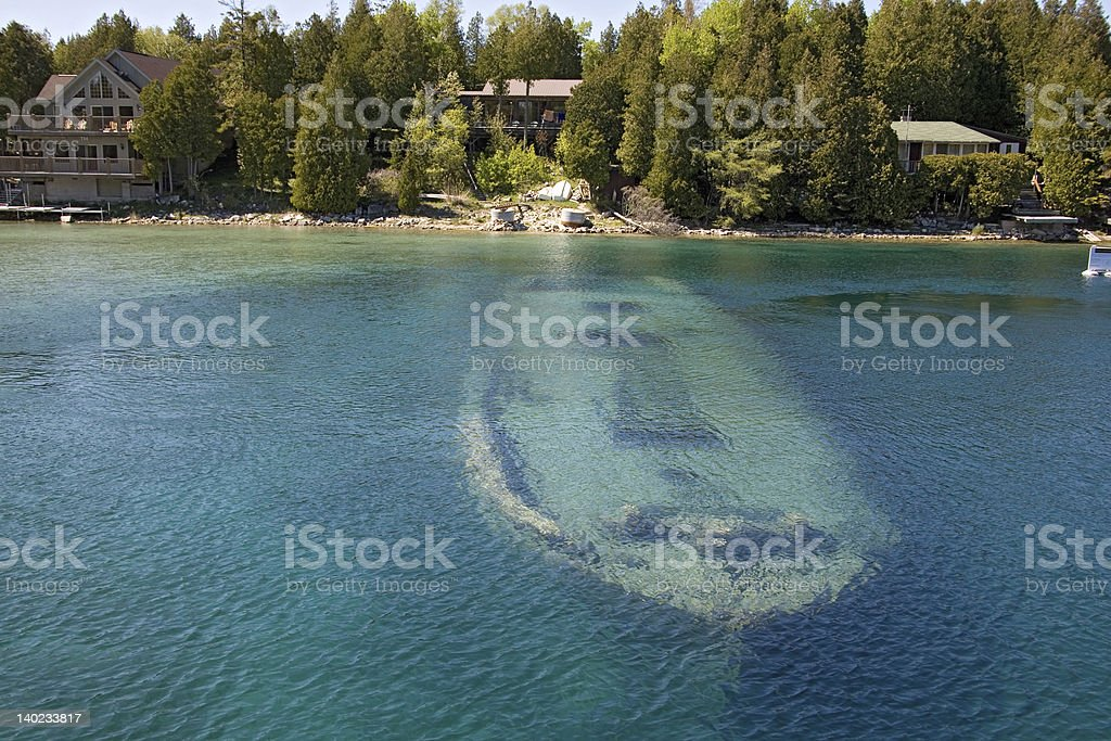 tobermory boat under water stock photo