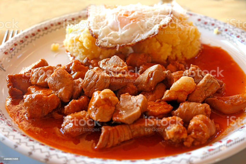 Tochitura: traditional Romanian dish beef and pork, eggs, polenta. stock photo