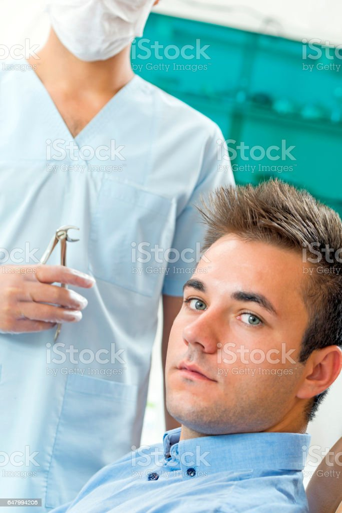 Today we prepare for a tooth extraction stock photo