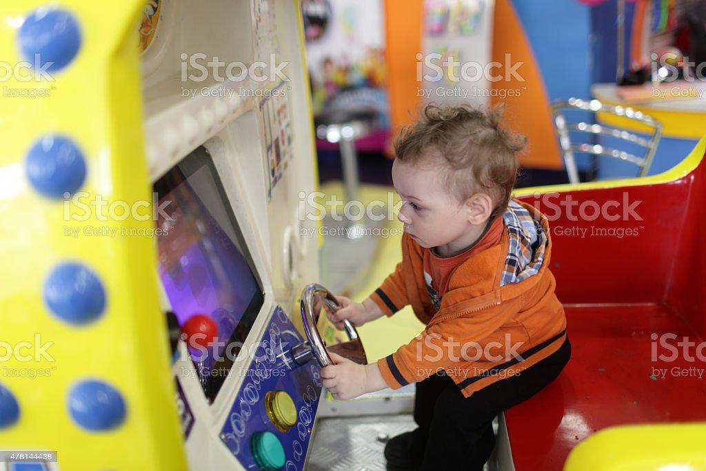 Toddler and amusement machine stock photo