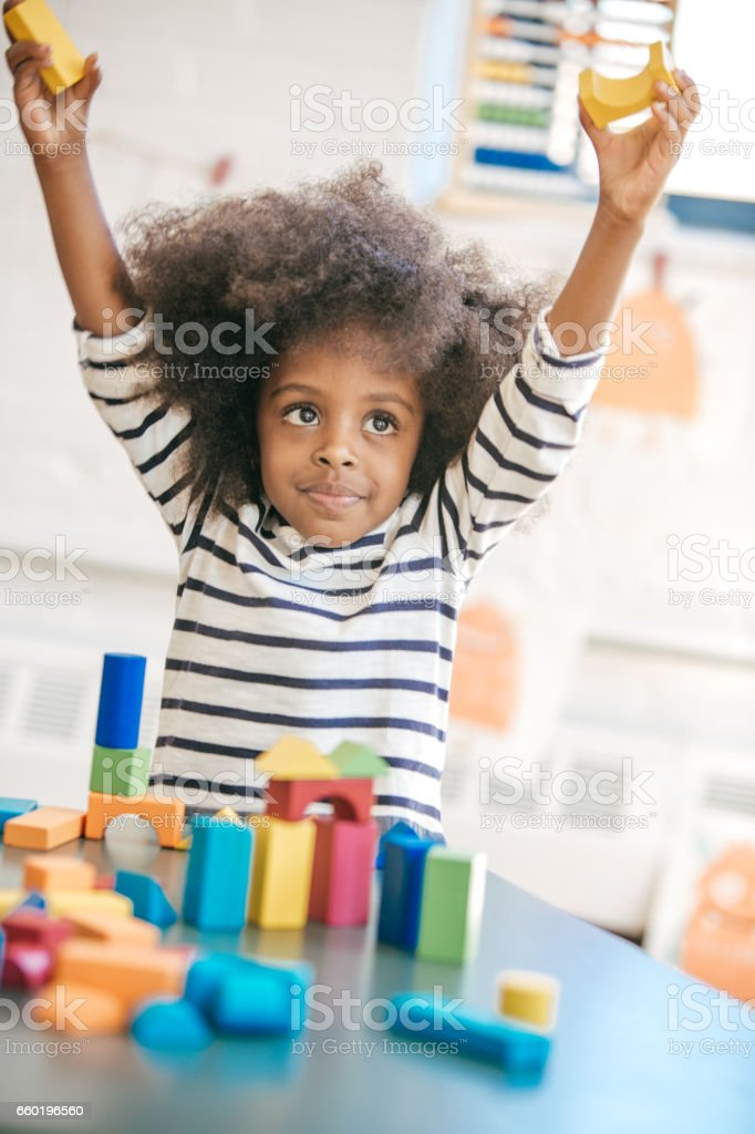 Toddler and educational process stock photo