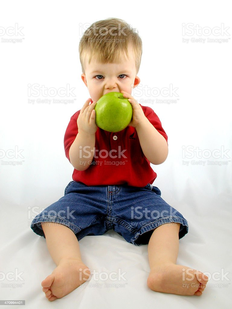 toddler and fruit series: Eating an Apple. royalty-free stock photo