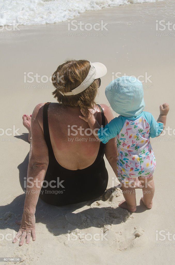 Toddler and Grandmother on Beach stock photo