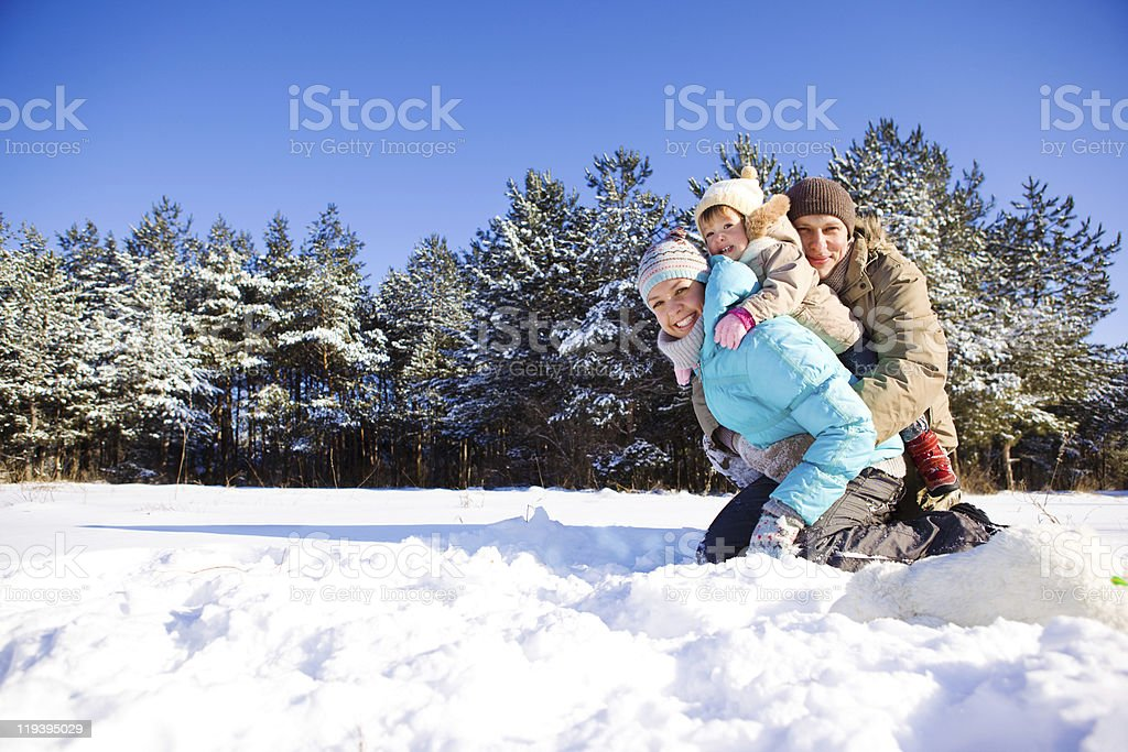 Toddler and her parents in park royalty-free stock photo