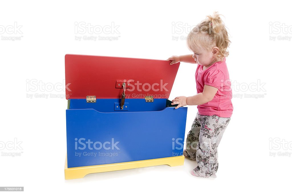 Toddler and Toy Box stock photo