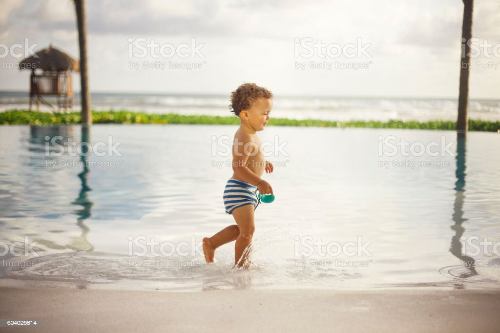 Toddler at the pool stock photo