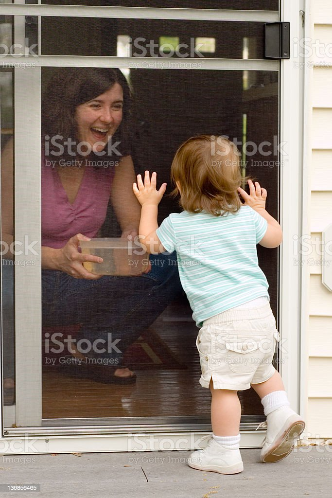 Toddler at the Screen Door stock photo