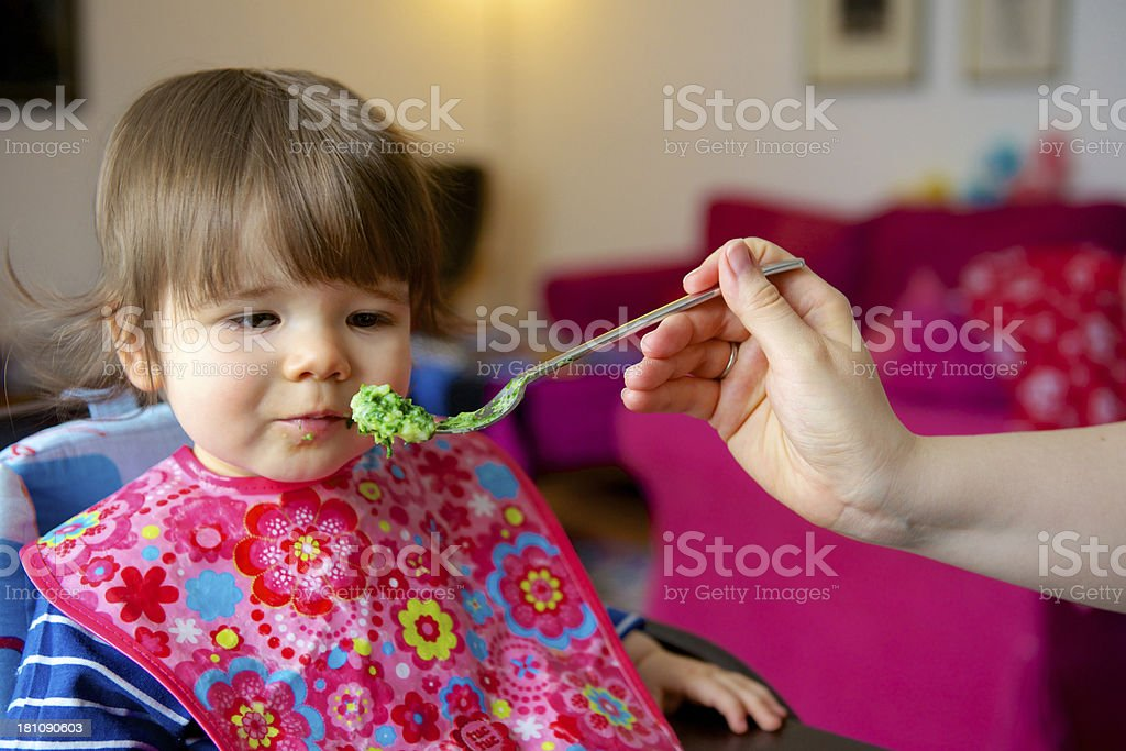 Toddler being fed stock photo