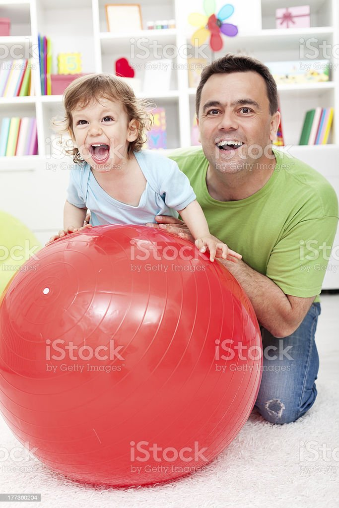 Toddler boy having fun with his father royalty-free stock photo