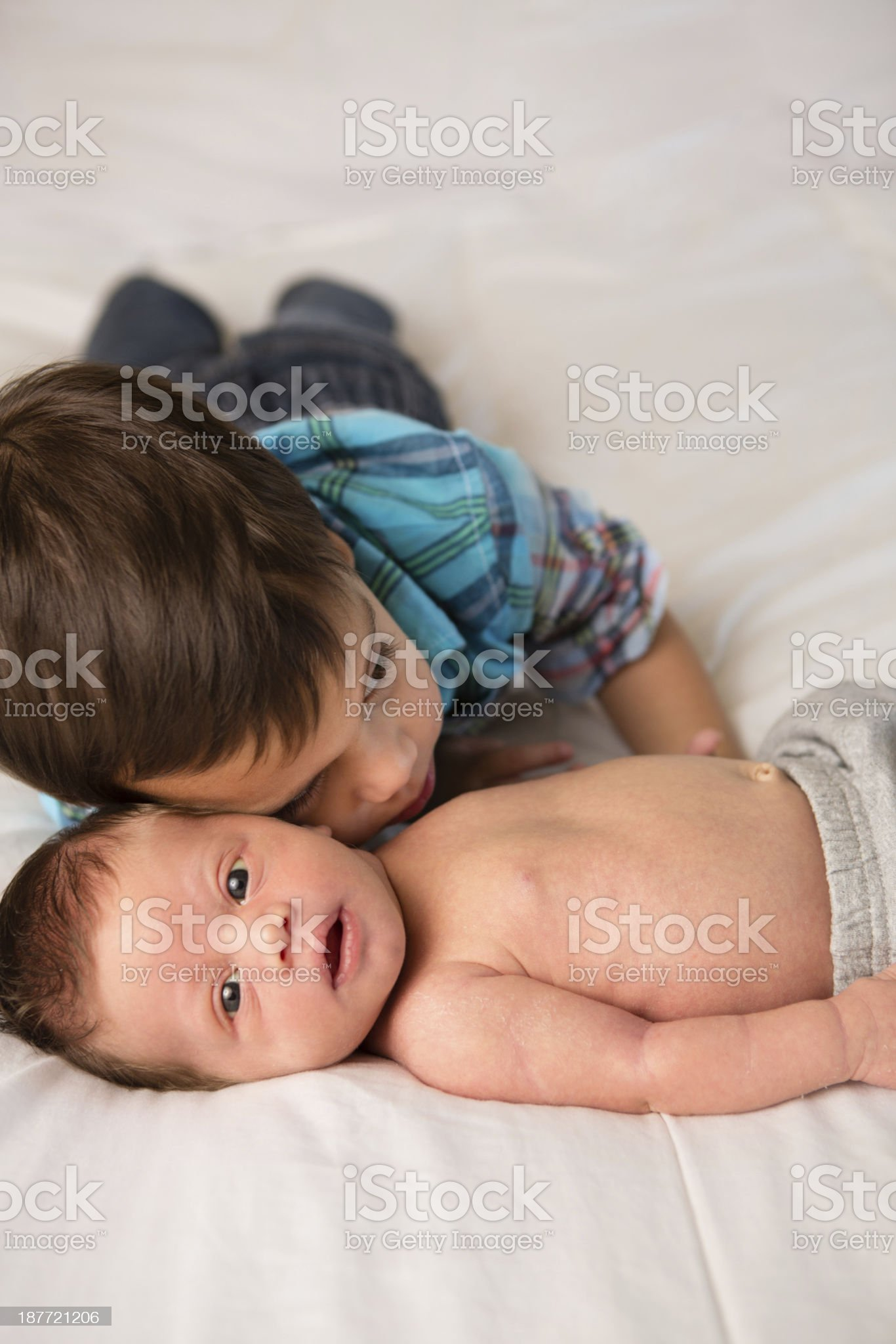 Toddler Boy Hugging His Newborn Brother royalty-free stock photo