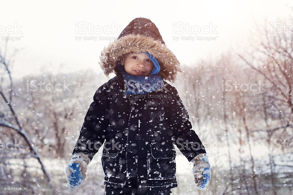 Toddler boy on a snow day stock photo