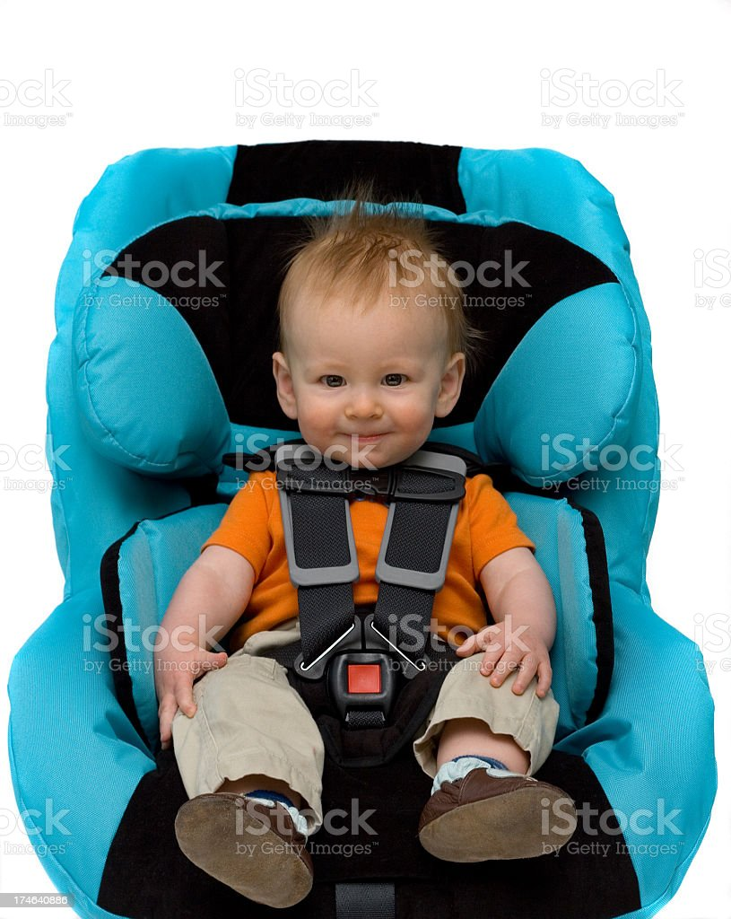 A toddler boy sitting in a blue car seat royalty-free stock photo