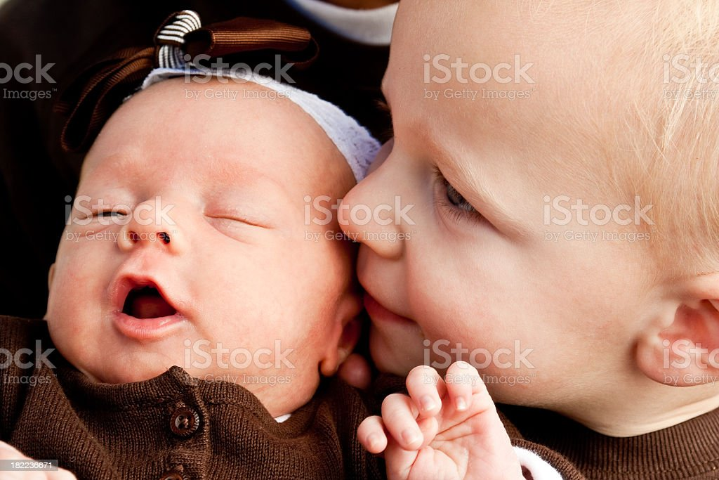Toddler Brother and Baby Sister stock photo