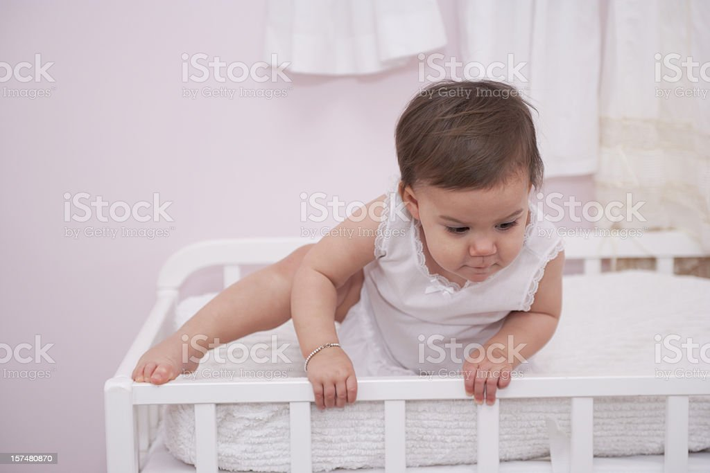 Toddler Climbing out of Crib (XXL) royalty-free stock photo