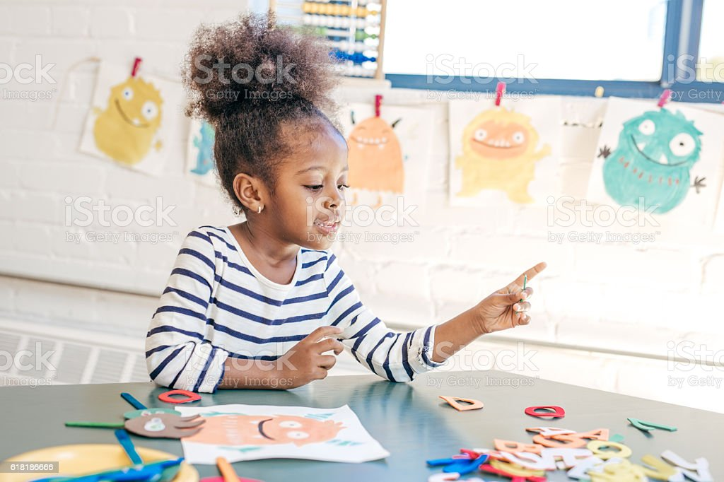 Toddler counting numbers stock photo