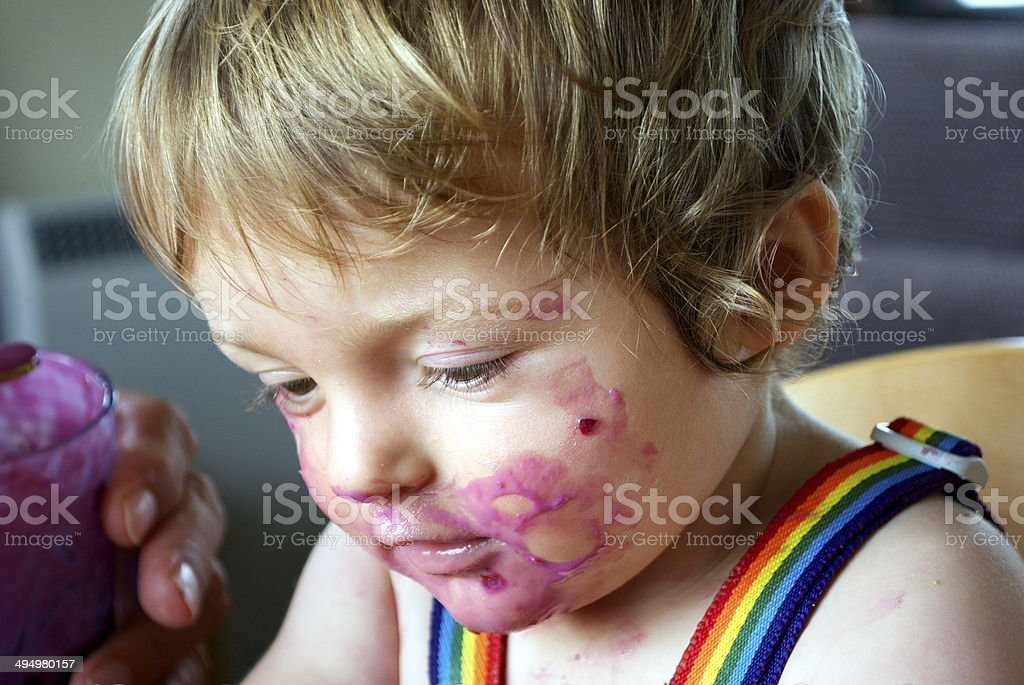 Toddler covered in Food stock photo