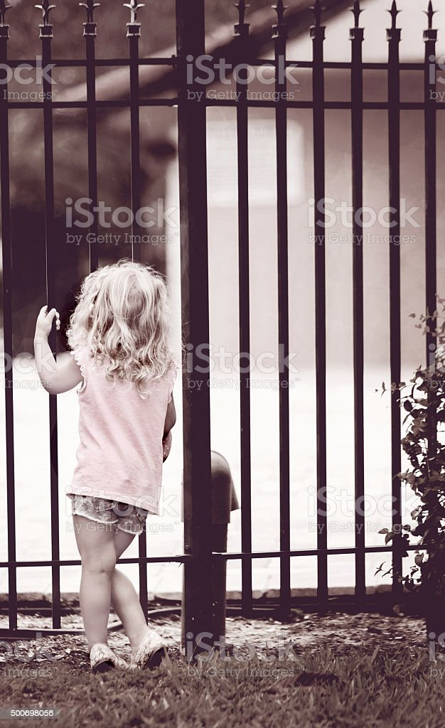 Toddler dreaming of playing stock photo