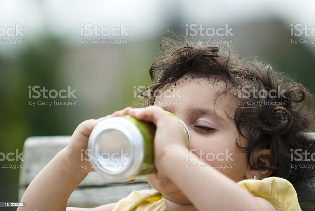 toddler drinking pop stock photo