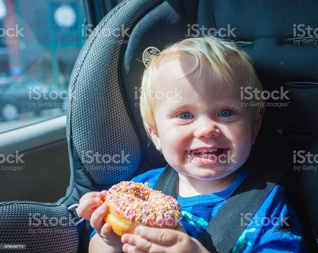 Toddler Eating Donut stock photo