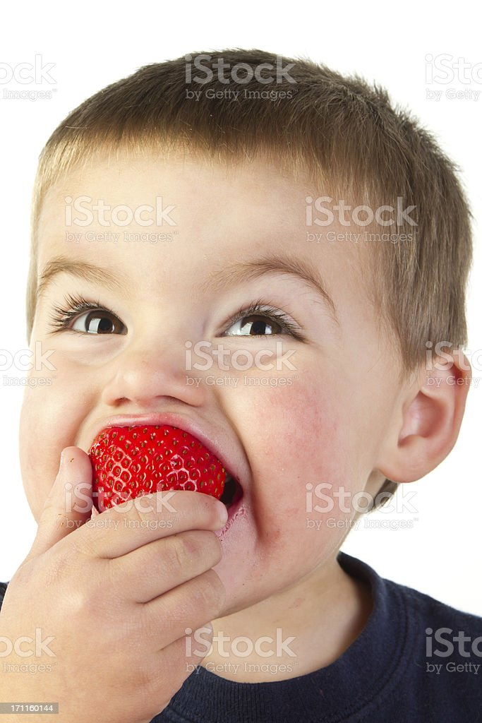Toddler Eating Strawberry royalty-free stock photo