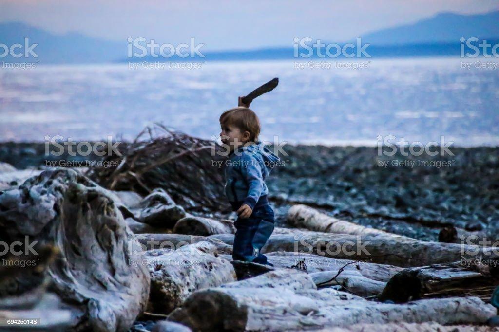 Toddler embracing beach life stock photo