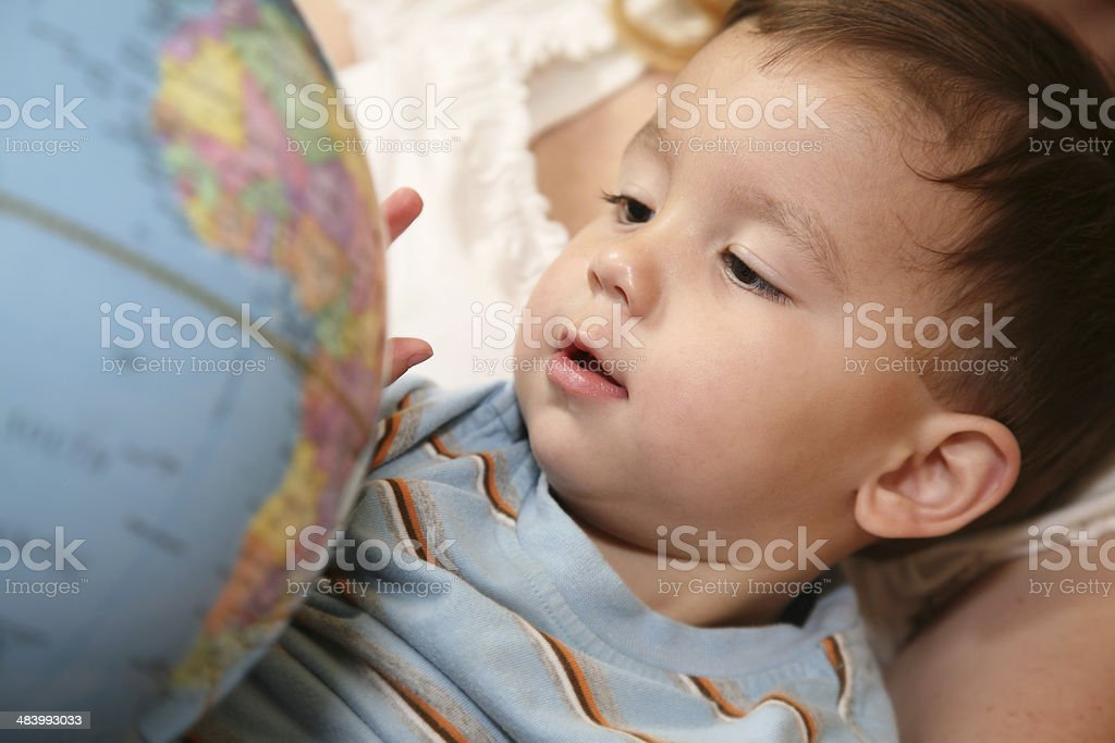 Toddler Enjoying Geography On A Globe stock photo