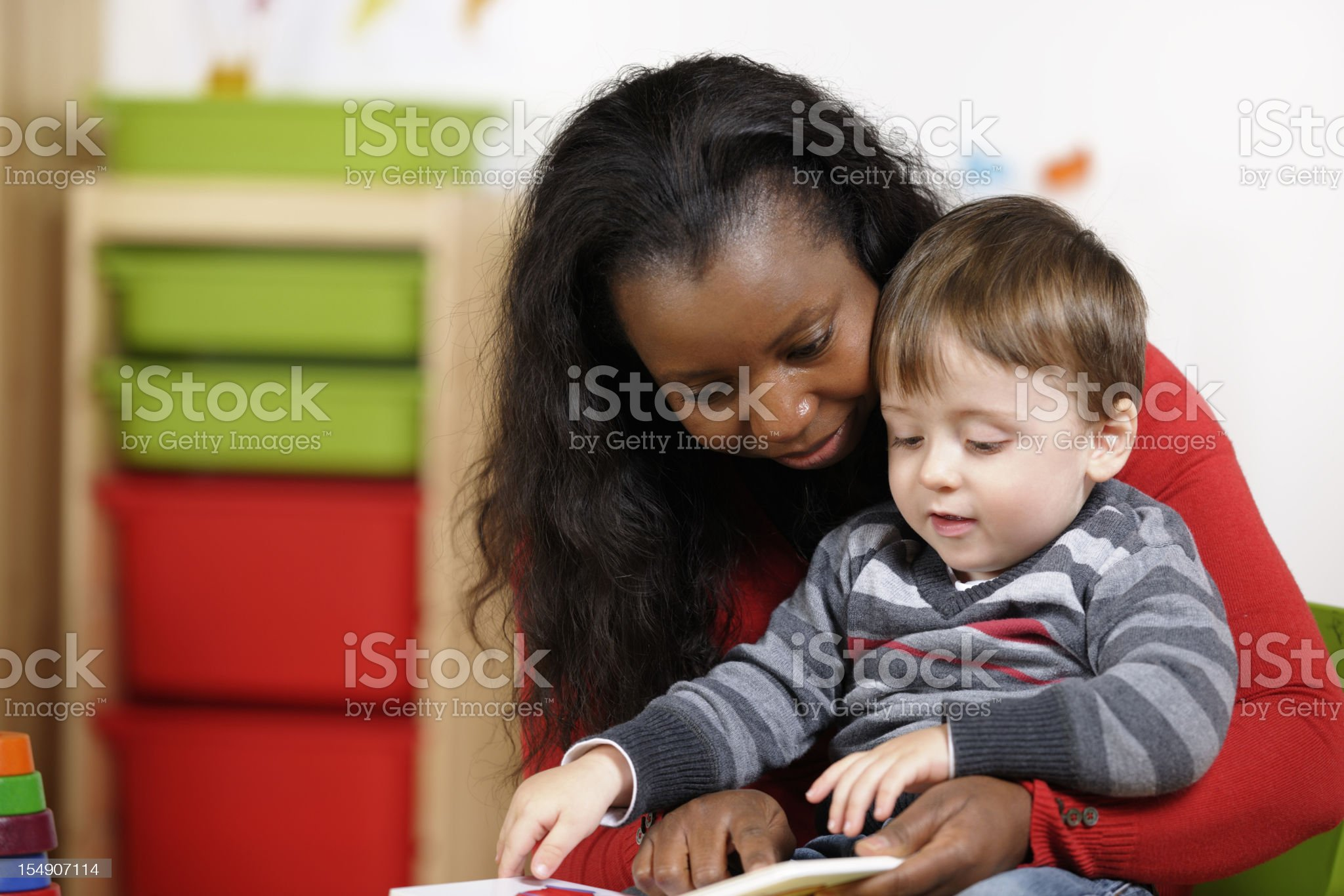 Toddler Enjoying Storytime With His Carer royalty-free stock photo